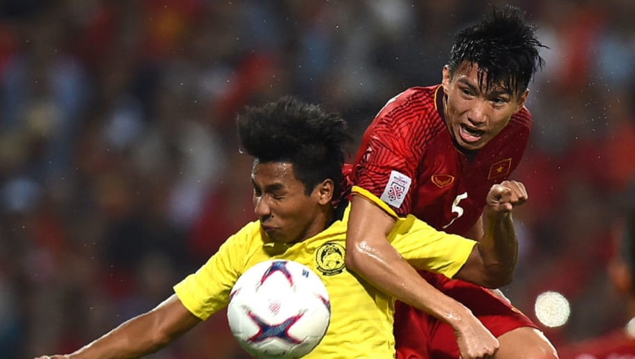 f5c3b69ea1 Malaysia s defender Syazwan Andik (L) fights for the ball with Vietnam s  defender Doan Van