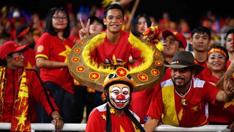 Vietnam's fans cheer before the start of the second leg of the AFF Suzuki Cup 2018 semifinal football match between Vietnam and the Philippines at the My Dinh Stadium in Hanoi on December 6, 2018. (Photo by Manan VATSYAYANA / AFP)        (Photo credit should read MANAN VATSYAYANA/AFP/Getty Images)