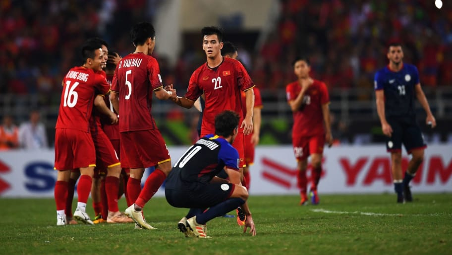 Vietnam's players celebrate at the end of the second leg of the AFF Suzuki Cup 2018 semifinal football match between Vietnam and the Philippines at the My Dinh Stadium in Hanoi on December 6, 2018. (Photo by Manan VATSYAYANA / AFP)        (Photo credit should read MANAN VATSYAYANA/AFP/Getty Images)