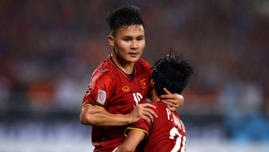 Vietnam's midfielder Nguyen Quang Hai (L) celebrates with teammate forward Phan Van Duc after scoring a goal during the second leg of the AFF Suzuki Cup 2018 semifinal football match between Vietnam and the Philippines at the My Dinh Stadium in Hanoi on December 6, 2018. (Photo by Nhac NGUYEN / AFP)        (Photo credit should read NHAC NGUYEN/AFP/Getty Images)
