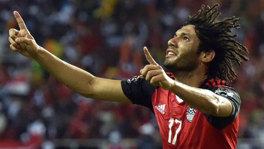 Egypt's midfielder Mohamed Elneny celebrates scoring the first goal of the match during the 2017 Africa Cup of Nations final football match between Egypt and Cameroon at the Stade de l'Amitie Sino-Gabonaise in Libreville on February 5, 2017. / AFP PHOTO / ISSOUF SANOGO        (Photo credit should read ISSOUF SANOGO/AFP/Getty Images)