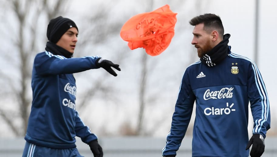 Argentina's Paulo Dybala (L) and Lionel Messi take part in a training session in Moscow on November 7, 2017. The team will face Russia in friendly match on November 11 and Nigeria on November 14. / AFP PHOTO / Kirill KUDRYAVTSEV        (Photo credit should read KIRILL KUDRYAVTSEV/AFP/Getty Images)