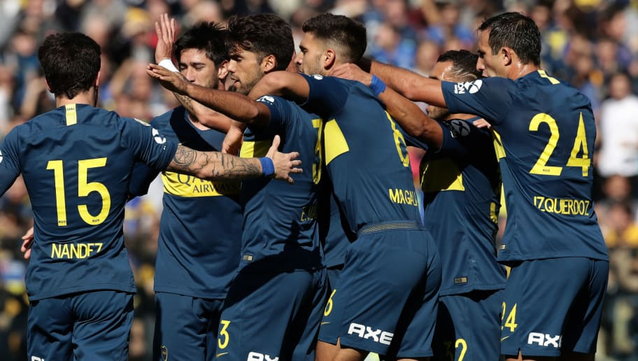 Boca Juniors' forward Cristian Pavon (C, hidden) celebrates with teammates after scoring a goal against Talleres during their Argentinian First Division Superliga football match at La Bombonera stadium, in Buenos Aires, on August 12, 2018. (Photo by ALEJANDRO PAGNI / AFP)        (Photo credit should read ALEJANDRO PAGNI/AFP/Getty Images)