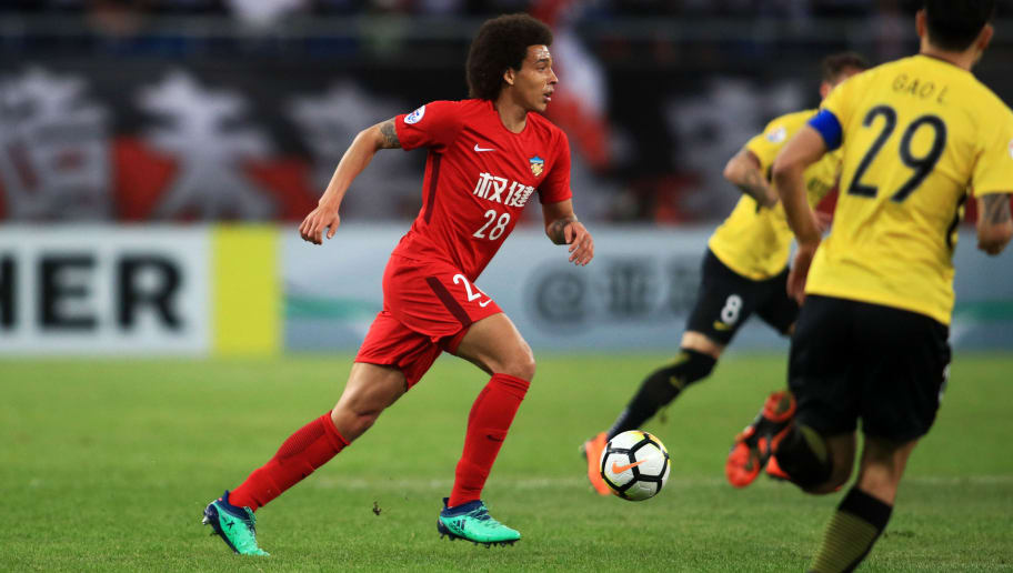 Tianjin Quanjian's Axel Witsel (L) kicks the ball during the AFC Champions League round of 16 football match between China's Tianjin Quanjian and Guangzhou Evergrande in Tianjin on May 8, 2018. (Photo by - / AFP) / China OUT        (Photo credit should read -/AFP/Getty Images)