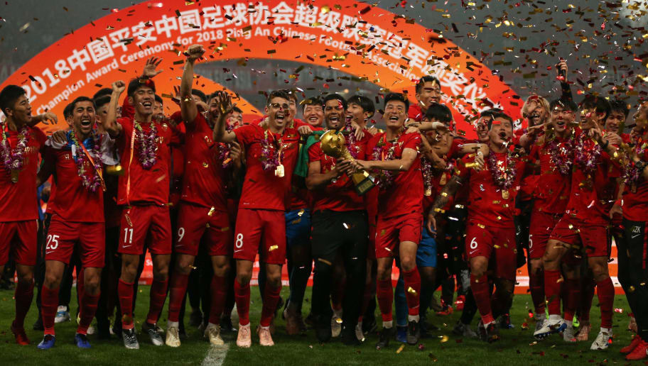 Players of Shanghai SIPG celebrate with their trophy after winning the Chinese Super League (CSL) football match in Shanghai on November 7, 2018. - Shanghai SIPG broke Guangzhou Evergrande's near-decade stranglehold on Chinese football on November 7, winning the Chinese Super League (CSL) for the first time (Photo by STR / AFP) / China OUT        (Photo credit should read STR/AFP/Getty Images)