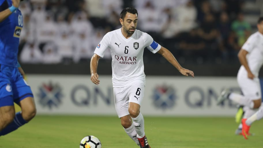 Al-Sadd's Xavi kicks the ball during the AFC Champions League quarter final match between Esteghlal FC and Al-Sadd SC at the Jassim Bin Hamad Stadium in Doha on September 17, 2018. (Photo by KARIM JAAFAR / AFP)        (Photo credit should read KARIM JAAFAR/AFP/Getty Images)