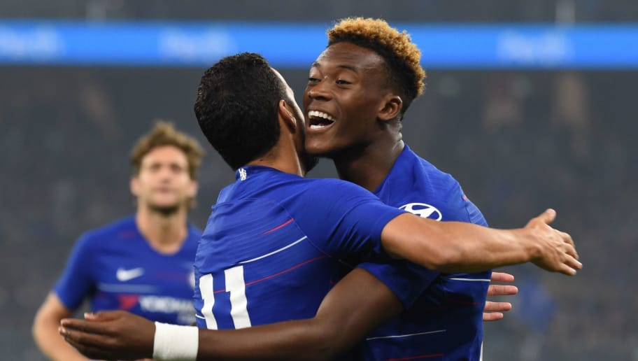 Chelsea's Callum Hudson-Odoi (R) celebrates with teammate Pedro after his cross helped in scoring his team's first goal against Perth Glory during their friendly football match at Optus stadium in Perth on July 23, 2018. (Photo by Greg Wood / AFP) / -- IMAGE RESTRICTED TO EDITORIAL USE - STRICTLY NO COMMERCIAL USE --        (Photo credit should read GREG WOOD/AFP/Getty Images)
