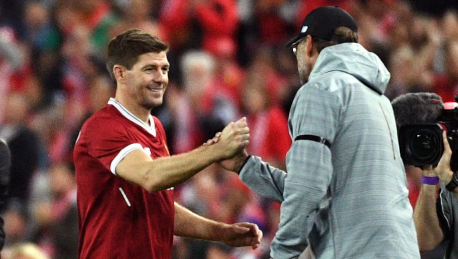 Liverpool player Steven Gerrard (2nd L) shakes hands with coach Jurgen Klopp after being substituted during their end-of-season friendly football match against Sydney FC at the Olympic Stadium in Sydney on May 24, 2017. / AFP PHOTO / WILLIAM WEST        (Photo credit should read WILLIAM WEST/AFP/Getty Images)
