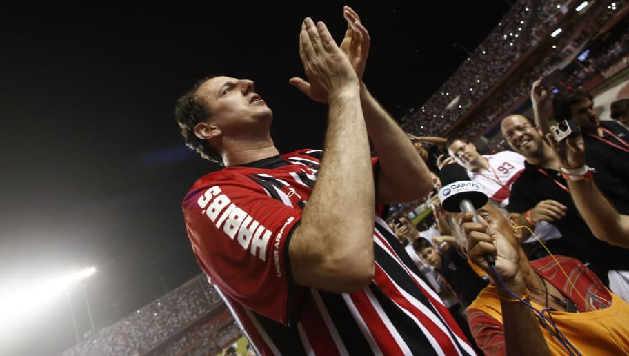 Goalkeeper Rogerio Ceni his honored at the end of a friendly match between 'Club World Cup football 1992-1993' and 'Club World Cup 2005' at Morumbi stadium in Sao Paulo, Brazil on December 11, 2015. Ceni (42) played his 25 year career in Sao Paulo FC, and as goalkeeper he scored 131 goals.    AFP PHOTO / Miguel SCHINCARIOL / AFP / Miguel Schincariol        (Photo credit should read MIGUEL SCHINCARIOL/AFP/Getty Images)