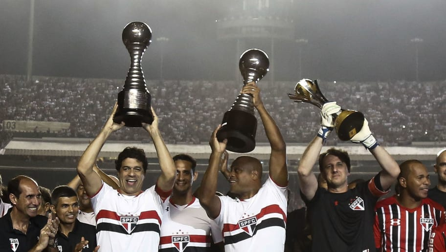 Players Rai (L), Ronaldao (C) and goalkeeper Rogerio Ceni hold their trophy received before a friendly match between 'Club World Cup football 1992-1993' and 'Club World Cup 2005' at Morumbi stadium in Sao Paulo, Brazil on December 11, 2015. Ceni (42) played his 25 year career in Sao Paulo FC, and as goalkeeper he scored 131 goals.     AFP PHOTO / Miguel SCHINCARIOL / AFP / Miguel Schincariol        (Photo credit should read MIGUEL SCHINCARIOL/AFP/Getty Images)