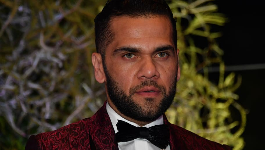 Brazilian PSG's footballer Dani Alves, arrives to participate in the charity auction for the Neymar Jr. Institute in Sao Paulo, Brazil on July 19, 2018. (Photo by NELSON ALMEIDA / AFP)        (Photo credit should read NELSON ALMEIDA/AFP/Getty Images)