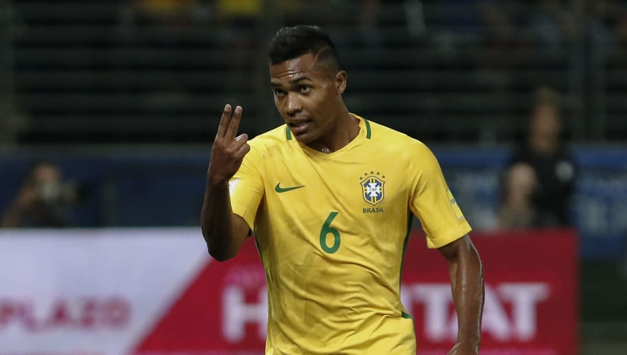 39c67710a10 Brazil s Alex Sandro gestures during a 2018 football World Cup qualifier  match against Chile in Sao