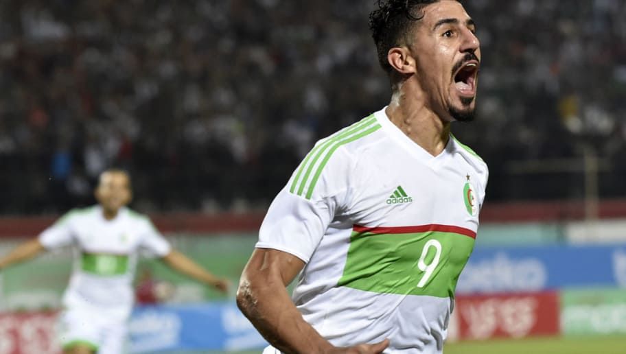 Algeria's Baghdad Bounedjah celebrates after scoring during the African Cup of Nations Group D Match between Algeria and Benin at the Mustapha Tchaker stadium in Blida on October 12, 2018. (Photo by RYAD KRAMDI / AFP)        (Photo credit should read RYAD KRAMDI/AFP/Getty Images)