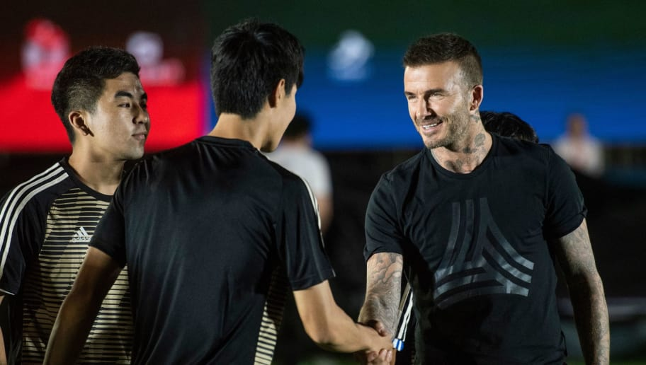 In this photo taken on June 20, 2018, former England footballer David Beckham attends a promotional event for a sportswear company and a collegiate football association in Beijing. (Photo by FRED DUFOUR / AFP)        (Photo credit should read FRED DUFOUR/AFP/Getty Images)