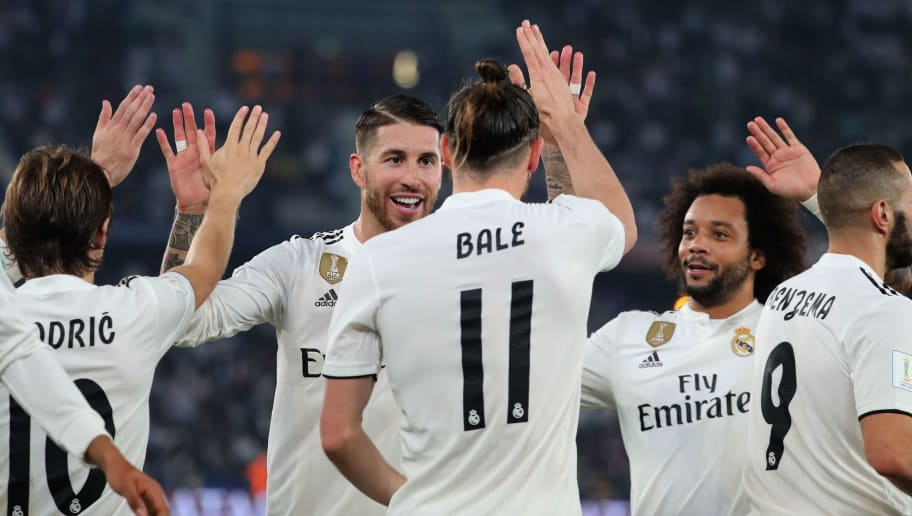 Real Madrid's Welsh forward Gareth Bale (C) celebrates his goal with teammates during the semi final football match of the FIFA Club World Cup 2018 tournament between Japan's Kashima Antlers and Spain's Real Madrid at the Zayed Sports City Stadium in Abu Dhabi, the capital of the United Arab Emirates, on December 19, 2018. (Photo by KARIM SAHIB / AFP)        (Photo credit should read KARIM SAHIB/AFP/Getty Images)