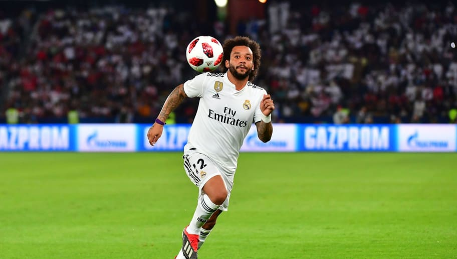 Real Madrid's Brazilian defender Marcelo runs after the ball during the FIFA Club World Cup final football match Spain's Real Madrid vs Abu Dhabi's Al Ain at the Zayed Sports City Stadium in Abu Dhabi, the capital of the United Arab Emirates, on December 22, 2018. (Photo by Giuseppe CACACE / AFP)        (Photo credit should read GIUSEPPE CACACE/AFP/Getty Images)
