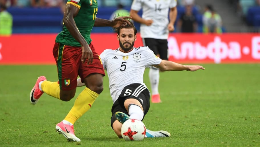 Germany's defender Marvin Plattenhardt (R) challenges Cameroon's forward Christian Bassogog during the 2017 FIFA Confederations Cup group B football match between Germany and Cameroon at the Fisht Stadium Stadium in Sochi on June 25, 2017. / AFP PHOTO / Patrik STOLLARZ        (Photo credit should read PATRIK STOLLARZ/AFP/Getty Images)