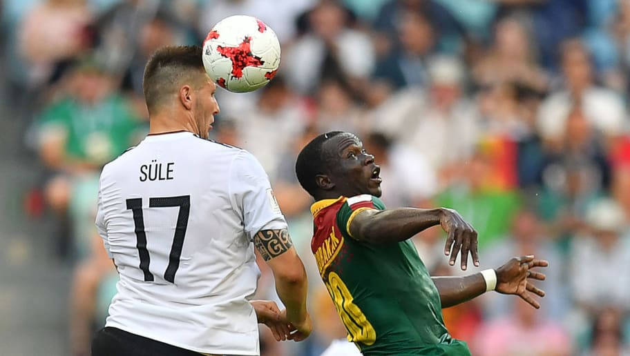 Cameroon's forward Vincent Aboubakar (R) heads the ball with Germany's defender Niklas Suele during the 2017 FIFA Confederations Cup group B football match between Germany and Cameroon at the Fisht Stadium Stadium in Sochi on June 25, 2017. / AFP PHOTO / Yuri CORTEZ        (Photo credit should read YURI CORTEZ/AFP/Getty Images)