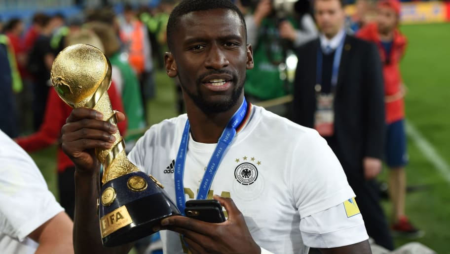 Germany's defender Antonio Ruediger holds the trophy after beating Chile 1-0 to win the 2017 Confederations Cup final football match between Chile and Germany at the Saint Petersburg Stadium in Saint Petersburg on July 2, 2017. / AFP PHOTO / PATRIK STOLLARZ        (Photo credit should read PATRIK STOLLARZ/AFP/Getty Images)