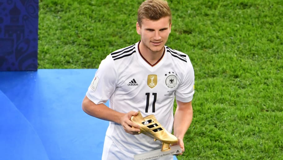 Germany's forward Timo Werner holds up the Golden Boot for best scorer after Germany beat Chile 1-0 in the 2017 Confederations Cup final football match between Chile and Germany at the Saint Petersburg Stadium in Saint Petersburg on July 2, 2017. / AFP PHOTO / Yuri CORTEZ        (Photo credit should read YURI CORTEZ/AFP/Getty Images)