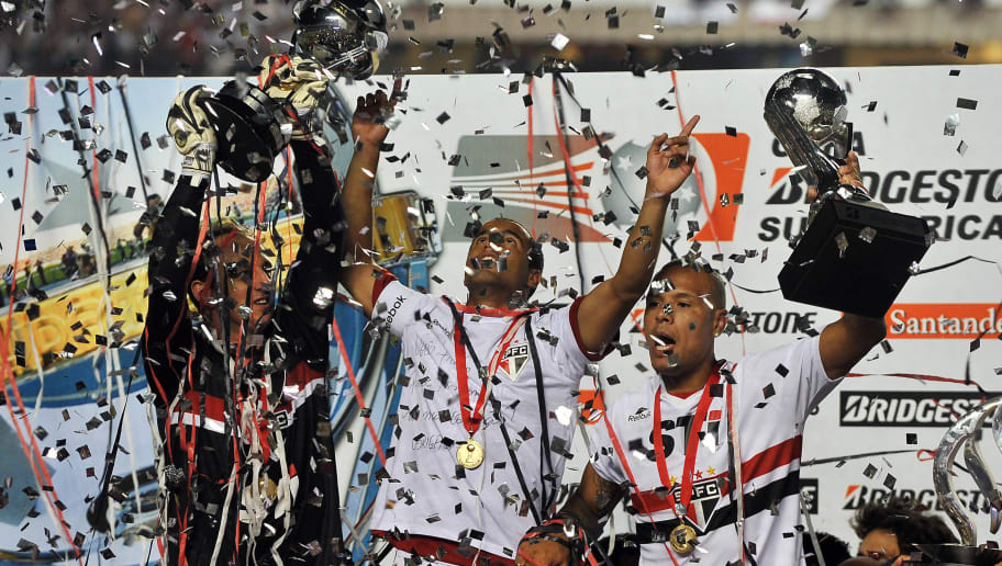 Brazil's Sao Paulos capitain Rogerio Ceni (L) and Lucas (C) and Luis Fabiano (L) holds the Libertadores Cup after winning the final match against Tigre of Argentina at Morumbi Stadium in Sao Paulo, Brazil on December 12, 2012. Sao Paulo won 2-0. AFP PHOTO / Nelson ALMEIDA / AFP PHOTO / -        (Photo credit should read -/AFP/Getty Images)