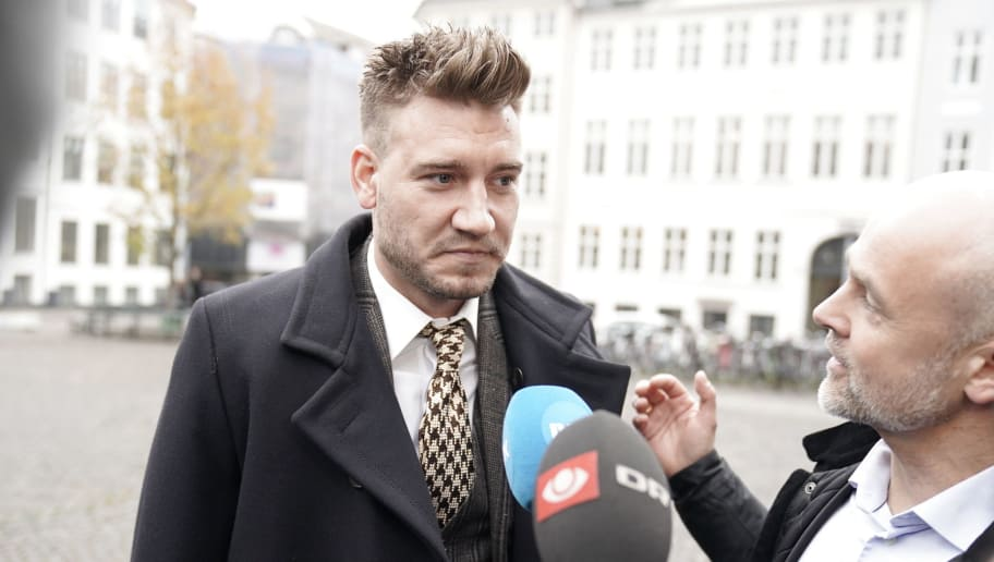 Rosenborg's Danish football player Nicklas Bendtner and lawyer Anders Nemeth talk to the media as they arrive for a hearing at Copenhagen City Council on November 2, 2018. - Nicklas Bendtner has been charged with violence against a taxi driver in Copenhagen while the driver has been charged with attempted violence. (Photo by Martin Sylvest / Ritzau Scanpix / AFP) / Denmark OUT        (Photo credit should read MARTIN SYLVEST/AFP/Getty Images)