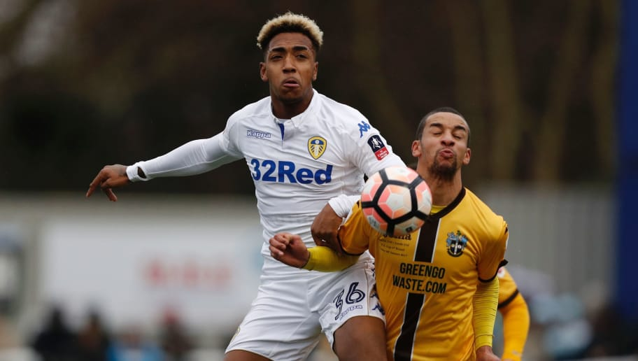 Leeds United's English midfielder Mallik Wilks (L) vies with Sutton United's English midfielder Craig Eastmond during the English FA Cup fourth round football match between Sutton United and Leeds United at the Borough Sports Ground in London on January 29, 2017. / AFP / Adrian DENNIS / RESTRICTED TO EDITORIAL USE. No use with unauthorized audio, video, data, fixture lists, club/league logos or 'live' services. Online in-match use limited to 75 images, no video emulation. No use in betting, games or single club/league/player publications.  /         (Photo credit should read ADRIAN DENNIS/AFP/Getty Images)