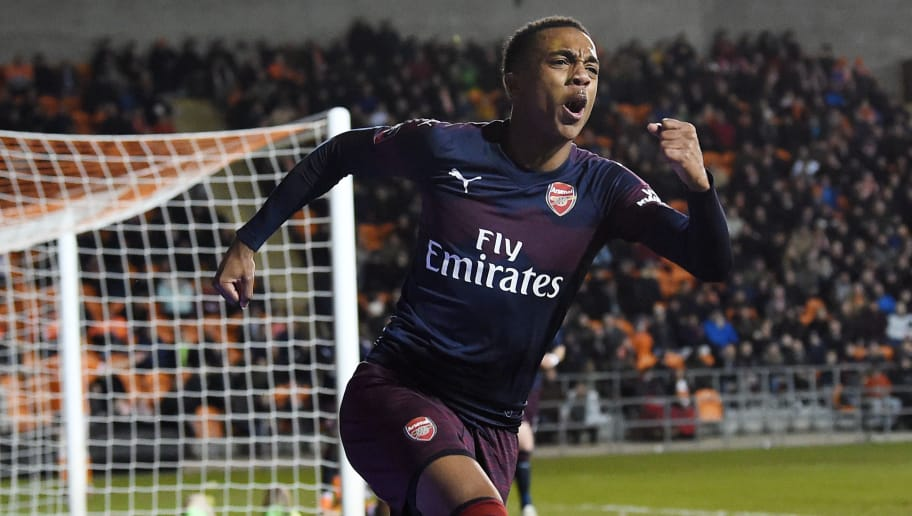 Arsenal's English midfielder Joe Willock celebrates scoring his and Arsenal's second goal during the English FA Cup third round football match between Blackpool and Arsenal at Bloomfield Road in Blackpool, north west England on January 5, 2019. (Photo by Paul ELLIS / AFP) / RESTRICTED TO EDITORIAL USE. No use with unauthorized audio, video, data, fixture lists, club/league logos or 'live' services. Online in-match use limited to 120 images. An additional 40 images may be used in extra time. No video emulation. Social media in-match use limited to 120 images. An additional 40 images may be used in extra time. No use in betting publications, games or single club/league/player publications. /         (Photo credit should read PAUL ELLIS/AFP/Getty Images)