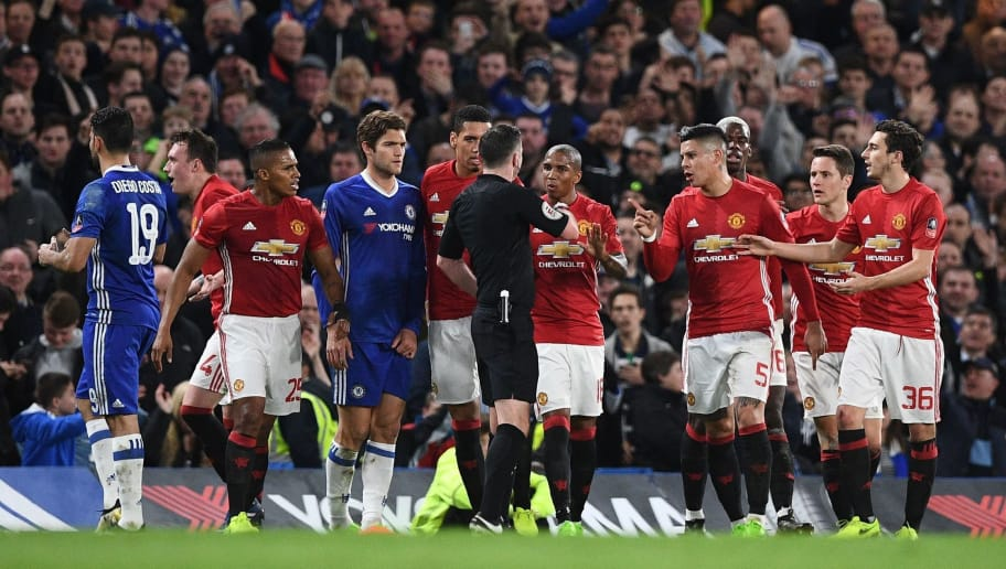 English referee Michael Oliver (C) speaks with Manchester united players after showing a red card for a second bookable offence, to Manchester United's Spanish midfielder Ander Herrera (2nd R) during the English FA Cup quarter final football match between Chelsea and Manchester United at Stamford Bridge in London on March 13, 2017. / AFP PHOTO / Justin TALLIS / RESTRICTED TO EDITORIAL USE. No use with unauthorized audio, video, data, fixture lists, club/league logos or 'live' services. Online in-match use limited to 75 images, no video emulation. No use in betting, games or single club/league/player publications.  /         (Photo credit should read JUSTIN TALLIS/AFP/Getty Images)