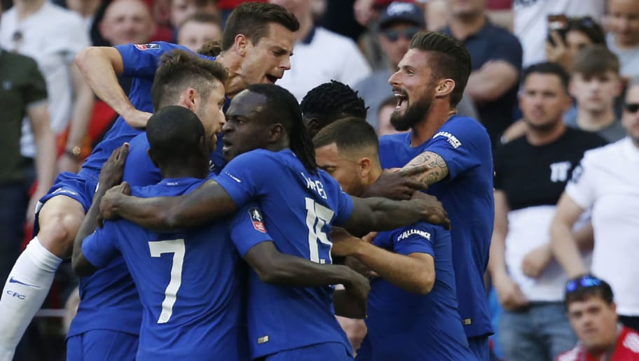 Chelsea's Belgian midfielder Eden Hazard (R) celebrates with teammates after scoring during the English FA Cup final football match between Chelsea and Manchester United at Wembley stadium in London on May 19, 2018. (Photo by Ian KINGTON / AFP) / NOT FOR MARKETING OR ADVERTISING USE / RESTRICTED TO EDITORIAL USE        (Photo credit should read IAN KINGTON/AFP/Getty Images)
