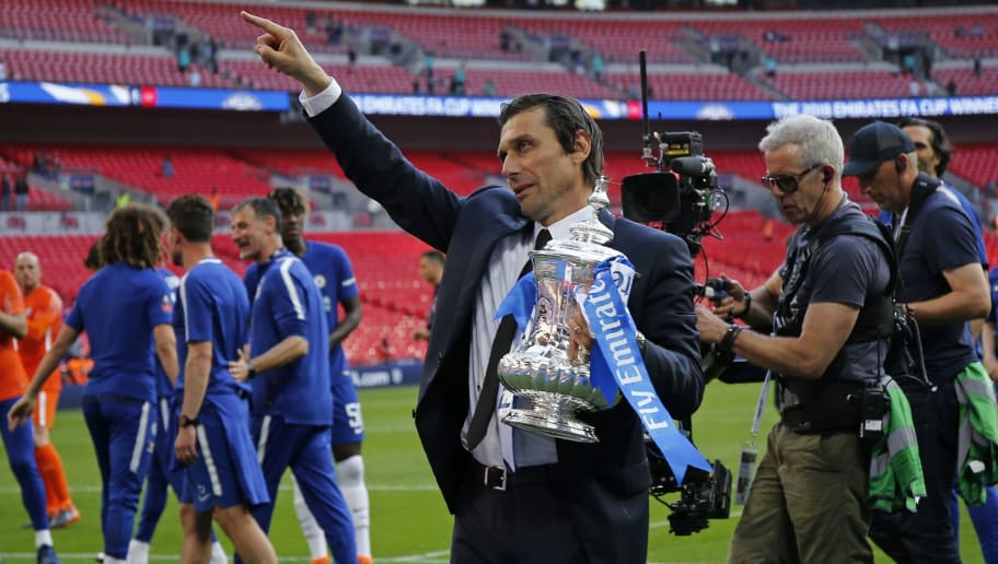 Chelsea's Italian head coach Antonio Conte gestures to the Chelsea supporters as Chelsea's players celebrate their win on the pitch after the English FA Cup final football match between Chelsea and Manchester United at Wembley stadium in London on May 19, 2018. - Chelsea beat Manchester United 1-0 to lift the FA Cup thanks to Eden Hazard's penalty at Wembley on Saturday to salvage a disappointing season. (Photo by Ian KINGTON / AFP) / NOT FOR MARKETING OR ADVERTISING USE / RESTRICTED TO EDITORIAL USE        (Photo credit should read IAN KINGTON/AFP/Getty Images)