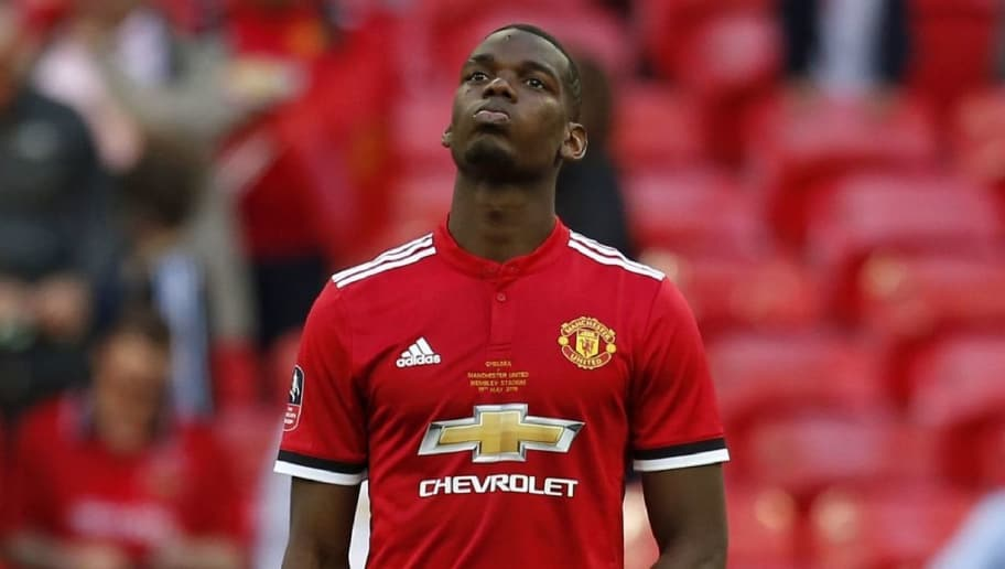 Manchester United's French midfielder Paul Pogba reacts to their defeat on the pitch after the English FA Cup final football match between Chelsea and Manchester United at Wembley stadium in London on May 19, 2018. - Chelsea beat Manchester United 1-0 to lift the FA Cup thanks to Eden Hazard's penalty at Wembley on Saturday to salvage a disappointing season. (Photo by Ian KINGTON / AFP) / NOT FOR MARKETING OR ADVERTISING USE / RESTRICTED TO EDITORIAL USE        (Photo credit should read IAN KINGTON/AFP/Getty Images)