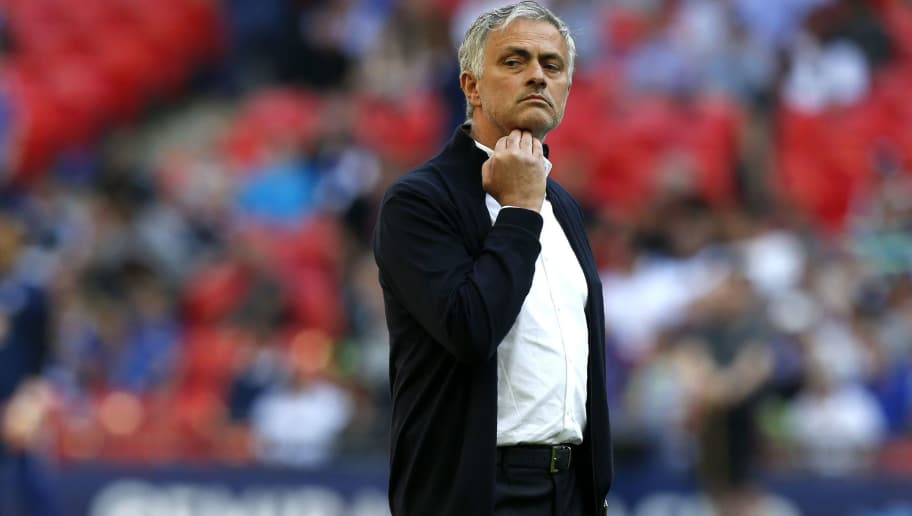 Manchester United's Portuguese manager Jose Mourinho checks out the conditions ahead of the English FA Cup final football match between Chelsea and Manchester United at Wembley stadium in London on May 19, 2018. (Photo by Ian KINGTON / AFP) / NOT FOR MARKETING OR ADVERTISING USE / RESTRICTED TO EDITORIAL USE        (Photo credit should read IAN KINGTON/AFP/Getty Images)