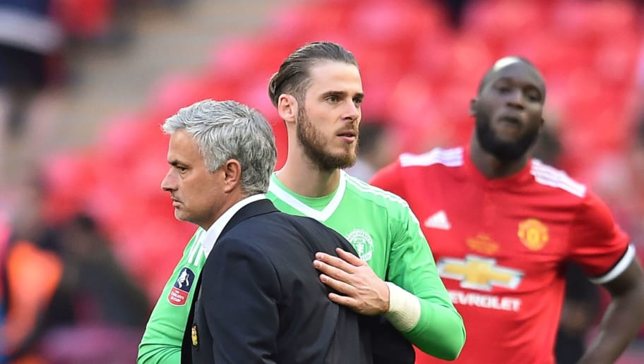 Manchester United's Portuguese manager Jose Mourinho (L) reacts with Manchester United's Spanish goalkeeper David de Gea (C) after losing the English FA Cup final football match between Chelsea and Manchester United at Wembley stadium in London on May 19, 2018. (Photo by Glyn KIRK / AFP) / NOT FOR MARKETING OR ADVERTISING USE / RESTRICTED TO EDITORIAL USE        (Photo credit should read GLYN KIRK/AFP/Getty Images)