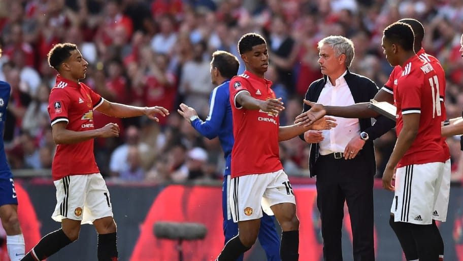 Manchester United's Portuguese manager Jose Mourinho (C) looks on as he substitutes Manchester United's English striker Marcus Rashford and Manchester United's English midfielder Jesse Lingard (L) for Manchester United's French striker Anthony Martial and Manchester United's Belgian striker Romelu Lukaku during the English FA Cup final football match between Chelsea and Manchester United at Wembley stadium in London on May 19, 2018. (Photo by Glyn KIRK / AFP) / NOT FOR MARKETING OR ADVERTISING USE / RESTRICTED TO EDITORIAL USE        (Photo credit should read GLYN KIRK/AFP/Getty Images)