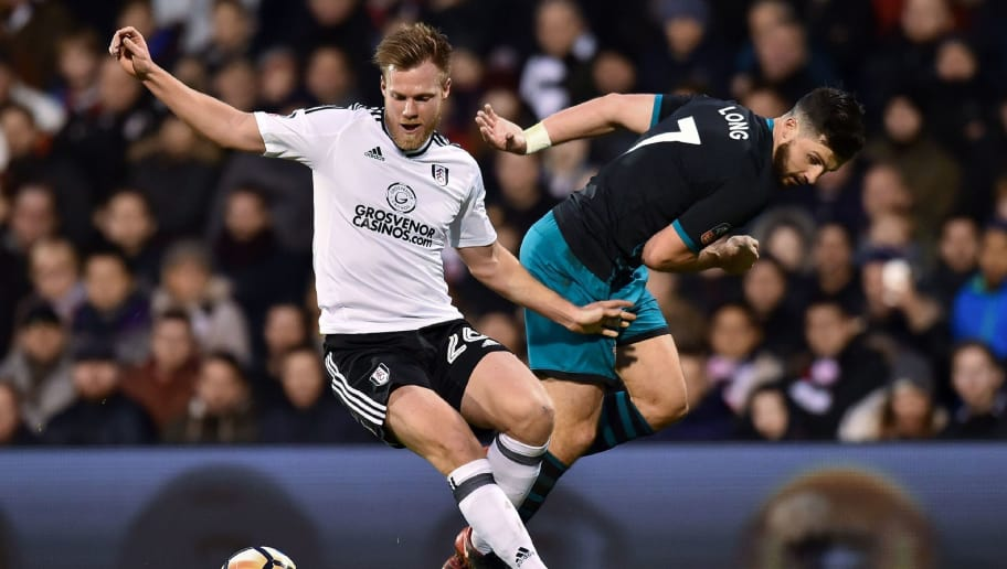 Fulham's Czech defender Tomas Kalas (L) vies with Southampton's Irish striker Shane Long during the English FA Cup third round football match between Fulham and Southampton at Craven Cottage in Fulham, west London on January 6, 2018. / AFP PHOTO / Glyn KIRK / RESTRICTED TO EDITORIAL USE. No use with unauthorized audio, video, data, fixture lists, club/league logos or 'live' services. Online in-match use limited to 75 images, no video emulation. No use in betting, games or single club/league/player publications.  /         (Photo credit should read GLYN KIRK/AFP/Getty Images)