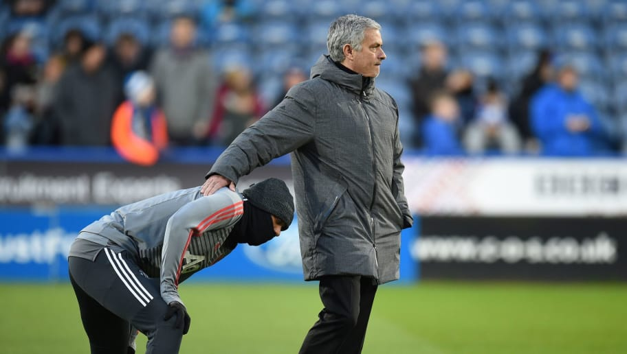 Manchester United's Portuguese manager Jose Mourinho gestures to Manchester United's French striker Anthony Martial (L) during the warm up ahead of the English FA Cup fifth round football match between Huddersfield Town and Manchester United at the John Smith's stadium in Huddersfield, northern England on February 17, 2018. / AFP PHOTO / Oli SCARFF / RESTRICTED TO EDITORIAL USE. No use with unauthorized audio, video, data, fixture lists, club/league logos or 'live' services. Online in-match use limited to 75 images, no video emulation. No use in betting, games or single club/league/player publications.  /         (Photo credit should read OLI SCARFF/AFP/Getty Images)