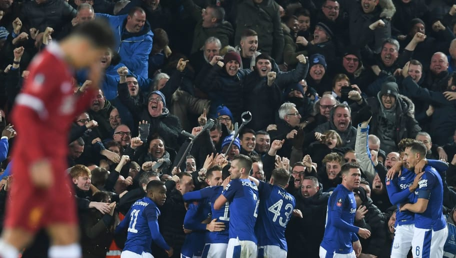 Everton players celebrate with the crowd after Everton's Icelandic midfielder Gylfi Sigurdsson scored their first goal to equalise 1-1 during the English FA Cup third round football match between Liverpool and Everton at Anfield in Liverpool, north west England on January 5, 2018. / AFP PHOTO / Paul ELLIS / RESTRICTED TO EDITORIAL USE. No use with unauthorized audio, video, data, fixture lists, club/league logos or 'live' services. Online in-match use limited to 75 images, no video emulation. No use in betting, games or single club/league/player publications.  /         (Photo credit should read PAUL ELLIS/AFP/Getty Images)
