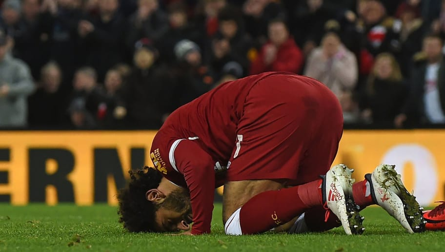 Liverpool's Egyptian midfielder Mohamed Salah celebrates after scoring their second goal during the English FA Cup fourth round football match between Liverpool and West Bromwich Albion at Anfield in Liverpool, north west England on January 27, 2018. / AFP PHOTO / PAUL ELLIS / RESTRICTED TO EDITORIAL USE. No use with unauthorized audio, video, data, fixture lists, club/league logos or 'live' services. Online in-match use limited to 75 images, no video emulation. No use in betting, games or single club/league/player publications.  /         (Photo credit should read PAUL ELLIS/AFP/Getty Images)