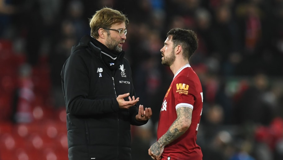 Liverpool's German manager Jurgen Klopp (L) speaks with Liverpool's English striker Danny Ings after the English FA Cup fourth round football match between Liverpool and West Bromwich Albion at Anfield in Liverpool, north west England on January 27, 2018. West Brom won the game 3-2. / AFP PHOTO / Paul ELLIS / RESTRICTED TO EDITORIAL USE. No use with unauthorized audio, video, data, fixture lists, club/league logos or 'live' services. Online in-match use limited to 75 images, no video emulation. No use in betting, games or single club/league/player publications.  /         (Photo credit should read PAUL ELLIS/AFP/Getty Images)
