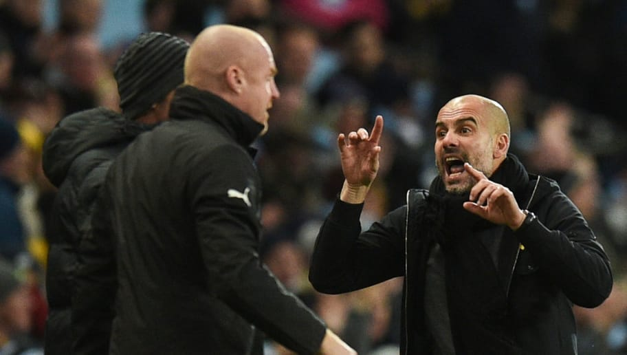 Manchester City's Spanish manager Pep Guardiola (R) gestures to Burnley's English manager Sean Dyche (L) during the English FA Cup third round football match between Manchester City and Burnley at Etihad Stadium in Manchester, north west England on January 6, 2018. / AFP PHOTO / Oli SCARFF / RESTRICTED TO EDITORIAL USE. No use with unauthorized audio, video, data, fixture lists, club/league logos or 'live' services. Online in-match use limited to 75 images, no video emulation. No use in betting, games or single club/league/player publications.  /         (Photo credit should read OLI SCARFF/AFP/Getty Images)