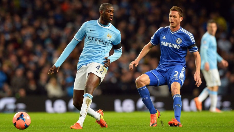Manchester City's Ivorian midfielder Yaya Toure vies with Chelsea's Serbian midfielder Nemanja Matic (R) during the English FA Cup fifth round football match between Manchester City and Chelsea at The Etihad Stadium in Manchester, northwest England on February 15, 2014. AFP PHOTO / PAUL ELLIS  RESTRICTED TO EDITORIAL USE. No use with unauthorized audio, video, data, fixture lists, club/league logos or live services. Online in-match use limited to 45 images, no video emulation. No use in betting, games or single club/league/player publications.        (Photo credit should read PAUL ELLIS/AFP/Getty Images)