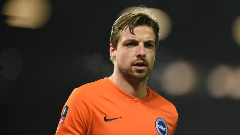 Brighton's Dutch goalkeeper Tim Krul gestures during the English FA Cup quarter-final football match between Manchester United and Brighton and Hove Albion at Old Trafford in Manchester, north west England, on March 17, 2018. / AFP PHOTO / Oli SCARFF / RESTRICTED TO EDITORIAL USE. No use with unauthorized audio, video, data, fixture lists, club/league logos or 'live' services. Online in-match use limited to 75 images, no video emulation. No use in betting, games or single club/league/player publications.  /         (Photo credit should read OLI SCARFF/AFP/Getty Images)