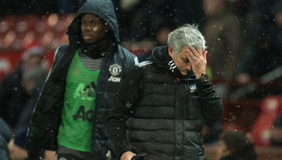 Manchester United's Portuguese manager Jose Mourinho (R) and French midfielder Paul Pogba leave after the English FA Cup quarter-final football match between Manchester United and Brighton and Hove Albion at Old Trafford in Manchester, north west England, on March 17, 2018. / AFP PHOTO / Oli SCARFF / RESTRICTED TO EDITORIAL USE. No use with unauthorized audio, video, data, fixture lists, club/league logos or 'live' services. Online in-match use limited to 75 images, no video emulation. No use in betting, games or single club/league/player publications.  /         (Photo credit should read OLI SCARFF/AFP/Getty Images)