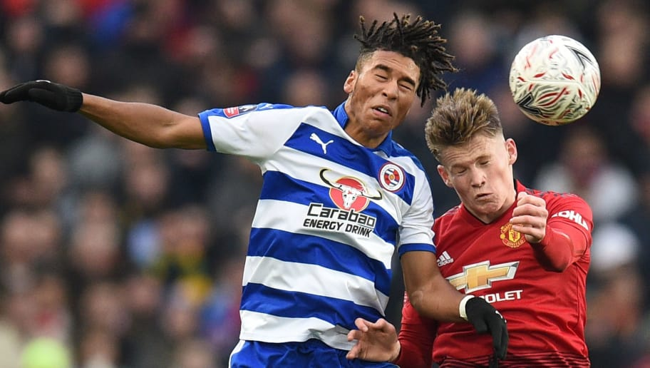 Manchester United's English midfielder Scott McTominay (R) goes up with Reading's English striker Danny Loader (L) for a header during the English FA Cup third round football match between Manchester United and Reading at Old Trafford in Manchester, north west England, on January 5, 2019. (Photo by Oli SCARFF / AFP) / RESTRICTED TO EDITORIAL USE. No use with unauthorized audio, video, data, fixture lists, club/league logos or 'live' services. Online in-match use limited to 120 images. An additional 40 images may be used in extra time. No video emulation. Social media in-match use limited to 120 images. An additional 40 images may be used in extra time. No use in betting publications, games or single club/league/player publications. /         (Photo credit should read OLI SCARFF/AFP/Getty Images)