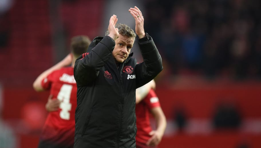 Manchester United's  Norwegian caretaker manager Ole Gunnar Solskjaer gestures to the crowd at the end of the English FA Cup third round football match between Manchester United and Reading at Old Trafford in Manchester, north west England, on January 5, 2019. (Photo by Oli SCARFF / AFP) / RESTRICTED TO EDITORIAL USE. No use with unauthorized audio, video, data, fixture lists, club/league logos or 'live' services. Online in-match use limited to 120 images. An additional 40 images may be used in extra time. No video emulation. Social media in-match use limited to 120 images. An additional 40 images may be used in extra time. No use in betting publications, games or single club/league/player publications. /         (Photo credit should read OLI SCARFF/AFP/Getty Images)
