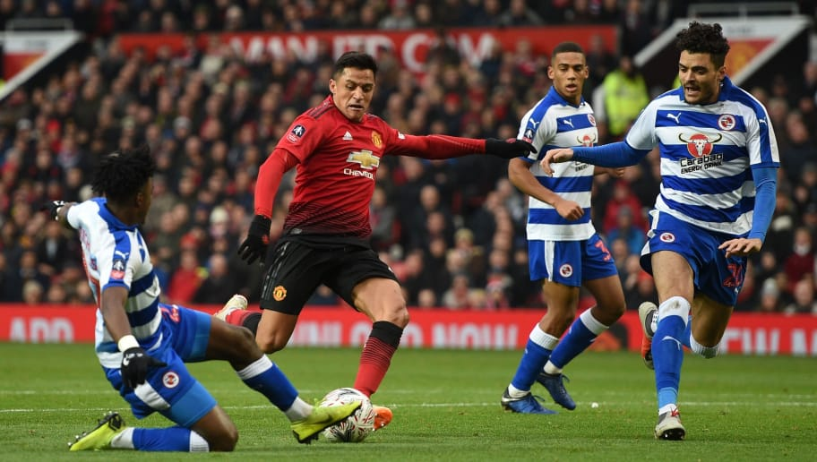 Manchester United's Chilean striker Alexis Sanchez (C) is blocked by Reading's English defender Omar Richards (L) during the English FA Cup third round football match between Manchester United and Reading at Old Trafford in Manchester, north west England, on January 5, 2019. (Photo by Oli SCARFF / AFP) / RESTRICTED TO EDITORIAL USE. No use with unauthorized audio, video, data, fixture lists, club/league logos or 'live' services. Online in-match use limited to 120 images. An additional 40 images may be used in extra time. No video emulation. Social media in-match use limited to 120 images. An additional 40 images may be used in extra time. No use in betting publications, games or single club/league/player publications. / (Photo credit should read OLI SCARFF/AFP/Getty Images)