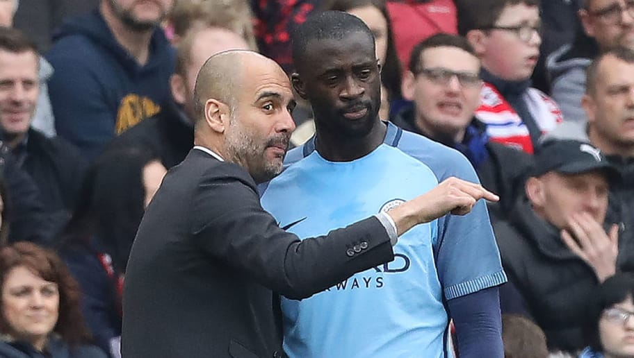 Manchester City's Spanish manager Pep Guardiola speaks with Manchester City's Ivorian midfielder Yaya Toure on the touchline during the English FA cup quarter final football match between Middlesbrough and Manchester City at the Riverside Stadium in Middlesbrough, north east England on March 11, 2017. / AFP PHOTO / Lindsey PARNABY / RESTRICTED TO EDITORIAL USE. No use with unauthorized audio, video, data, fixture lists, club/league logos or 'live' services. Online in-match use limited to 75 images, no video emulation. No use in betting, games or single club/league/player publications.  /         (Photo credit should read LINDSEY PARNABY/AFP/Getty Images)