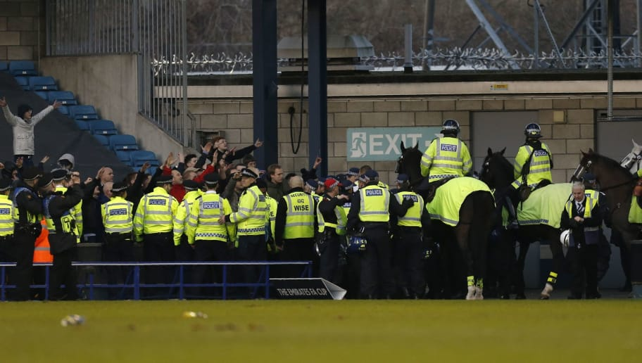 Police and horses keep supporters apart on the pitch after the English FA Cup fifth round football match between Millwall and Leicester City at The Den in south London on February 18, 2017. Millwall won the game 1-0. / AFP / Ian KINGTON / RESTRICTED TO EDITORIAL USE. No use with unauthorized audio, video, data, fixture lists, club/league logos or 'live' services. Online in-match use limited to 75 images, no video emulation. No use in betting, games or single club/league/player publications.  /         (Photo credit should read IAN KINGTON/AFP/Getty Images)