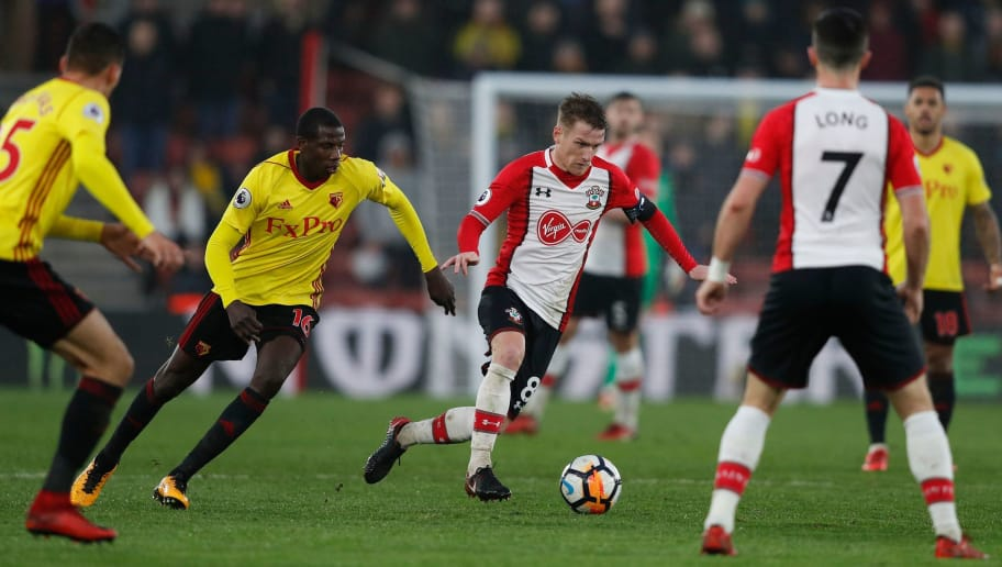 Southampton's Northern Irish midfielder Steven Davis (C) runs with the ball chased by Watford's French midfielder Abdoulaye Doucoure (2L) during the English FA Cup fourth round football match between Southampton and Watford at St Mary's Stadium in Southampton, southern England on January 27, 2018. / AFP PHOTO / Adrian DENNIS / RESTRICTED TO EDITORIAL USE. No use with unauthorized audio, video, data, fixture lists, club/league logos or 'live' services. Online in-match use limited to 75 images, no video emulation. No use in betting, games or single club/league/player publications.  /         (Photo credit should read ADRIAN DENNIS/AFP/Getty Images)